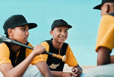 Buy stock photo Cropped shot of baseball players chatting while sitting together