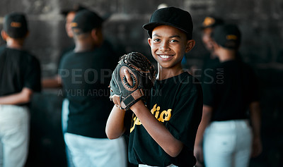 Buy stock photo Portrait of a young baseball player wearing baseball mitts with his teammates standing in the background