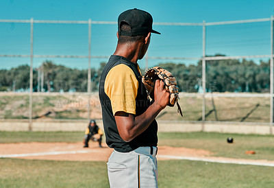 Buy stock photo Shot of a young baseball player getting ready to pitch the ball during a game outdoors