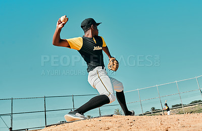 Buy stock photo Shot of a young baseball player pitching the ball during a game outdoors