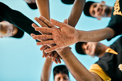 Buy stock photo Shot of a team of young baseball players joining their hands together in a huddle during a game