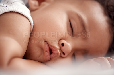 Buy stock photo Shot of an adorable baby boy sleeping peacefully on the bed at home