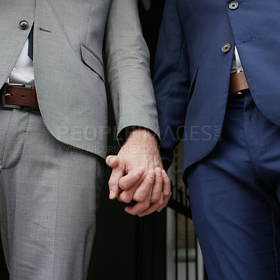 Buy stock photo Cropped shot of two men holding hands on their wedding day