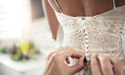 Buy stock photo Cropped shot of an unrecognisable woman helping the bride with her dress