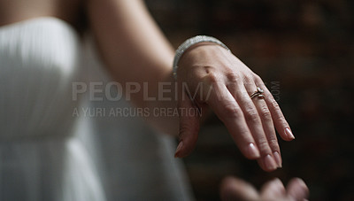 Buy stock photo Cropped shot of an unrecognisable couple exchanging rings on their wedding day