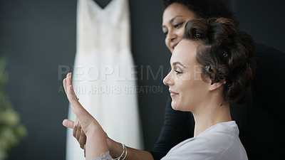 Buy stock photo Cropped shot of a beautiful bride getting her hair done on her wedding day