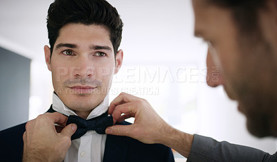 Buy stock photo Shot of the groom and his best man getting ready in a room