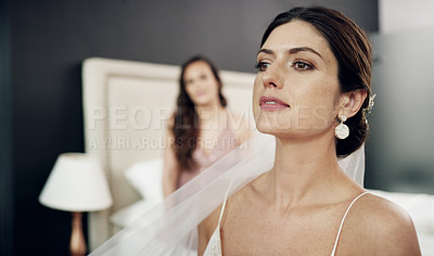 Buy stock photo Shot of a beautiful bride sitting in a bedroom before her wedding ceremony