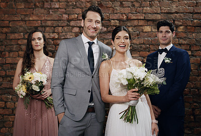 Buy stock photo Shot of a couple posing with their best man and maid of honour on their wedding day