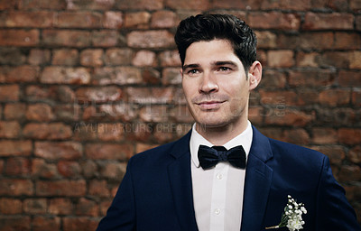 Buy stock photo Shot of a handsome young man looking well-dressed on his wedding day