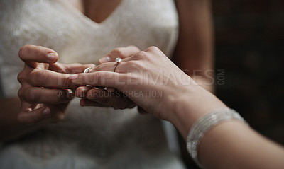 Buy stock photo Cropped shot of two unrecognisable women exchanging rings on their wedding day