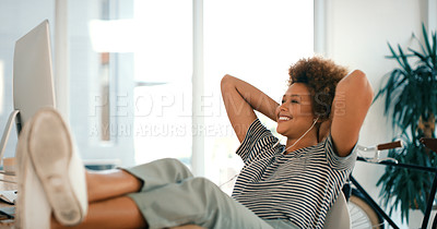 Buy stock photo Shot of a young designer taking a break at her desk in an office