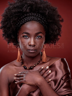 Buy stock photo Cropped portrait of a beautiful young woman posing against a red background