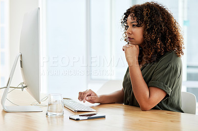 Buy stock photo Shot of a businesswoman sitting at her desk while working on her computer