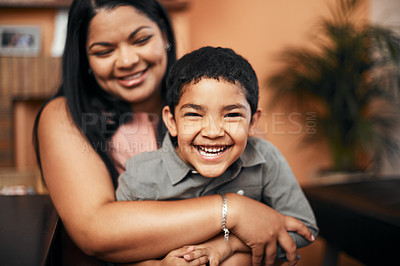Buy stock photo Portrait of an adorable little boy bonding with his mother at home