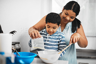 Buy stock photo Shot of a mother and her little son baking together at home