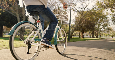 Buy stock photo Cropped shot of a senior man riding his bicycle in the park
