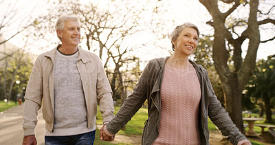 Buy stock photo Shot of a senior couple going for a romantic walk in the park
