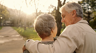Buy stock photo Rearview shot of a senior couple going for a romantic walk in the park