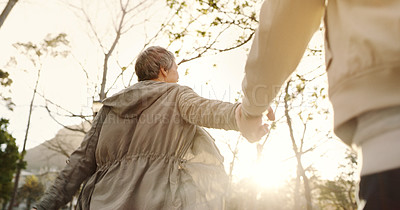 Buy stock photo Low angle shot of a senior couple going for a romantic walk in the park