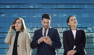 Buy stock photo Shot of a group of young businesspeople waiting together against an urban background