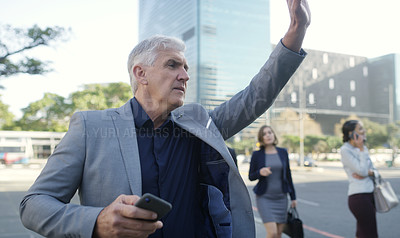 Buy stock photo Shot of a mature businessman using a smartphone and waving while walking through the city