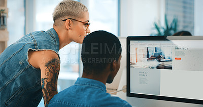 Buy stock photo Shot of two young designers working together on a computer in an office