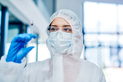 Buy stock photo Closeup shot of a healthcare worker wearing a hazmat suit and holding a syringe