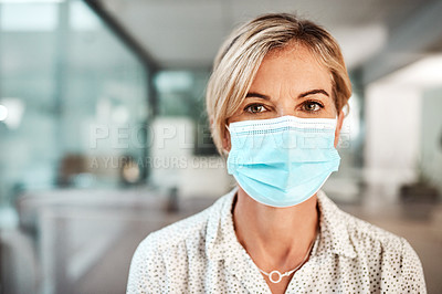 Buy stock photo Portrait of a mature businesswoman wearing a mask in an office