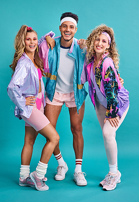 Buy stock photo Shot of three young people posing together in 80s clothing against a blue background