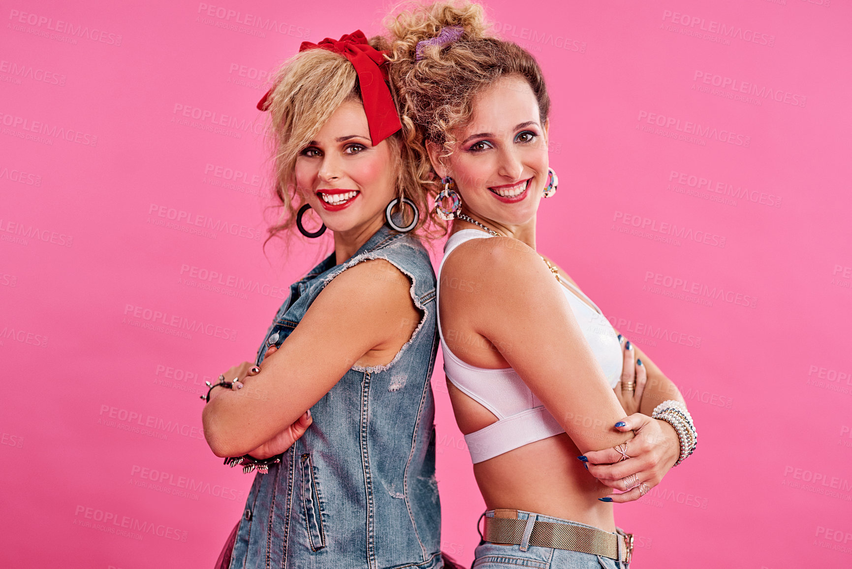 Buy stock photo Studio shot of two beautiful young women styled in 80s clothing