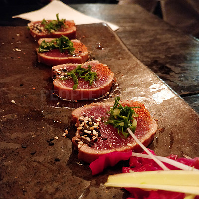 Buy stock photo Shot of tuna tataki served on a platter in a restaurant