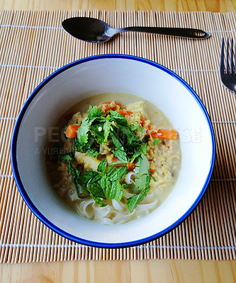 Buy stock photo Shot of a bowl of traditional Vietnamese pho on a table at a restaurant