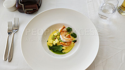 Buy stock photo Shot of prawns served with diced pineapples and sauce on a plate in a restaurant
