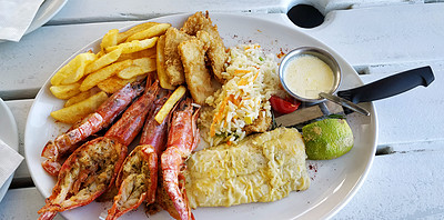 Buy stock photo Shot of king prawns served with a variety of seafood on a platter