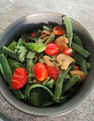 Buy stock photo Shot of a bowl of spinach pasta stir fried with mushrooms and tomatoes