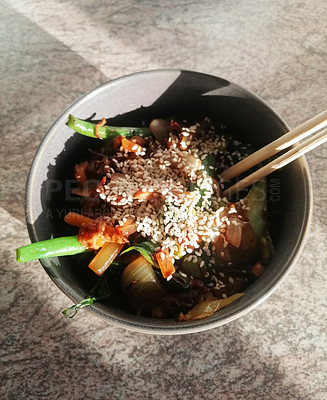 Buy stock photo Shot of a bowl of stir fried vegetables served with chopsticks