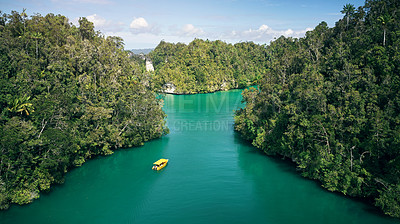 Buy stock photo Shot of a boat riding around an island on the Indian ocean
