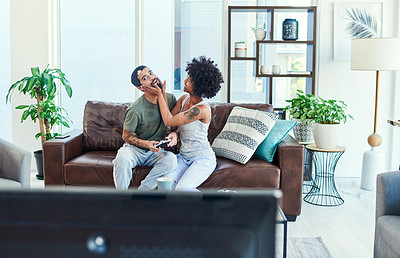 Buy stock photo Shot of a woman trying to get her boyfriend's attention while he plays video games