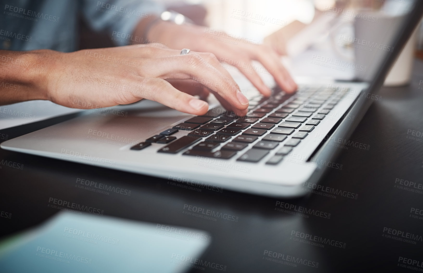 Buy stock photo Shot of an unrecognizable man working on a laptop