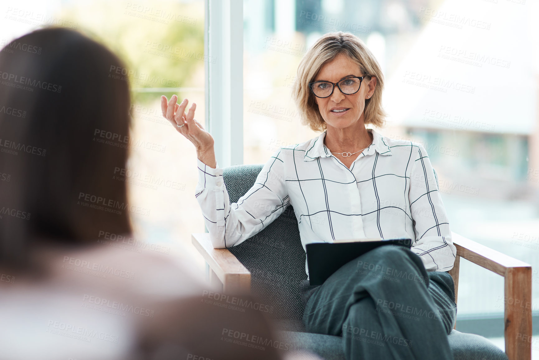 Buy stock photo Shot of a mature psychologist having a therapeutic session with her patient