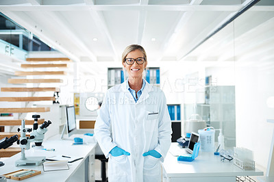 Buy stock photo Portrait of a mature scientist standing in a lab