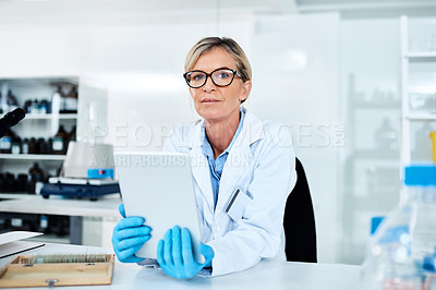 Buy stock photo Portrait of a mature scientist using a digital tablet in a lab