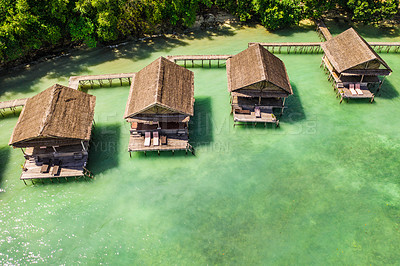 Buy stock photo High angle shot of the overwater bungalows along the coast of the Raja Ampat Islands in Indonesia