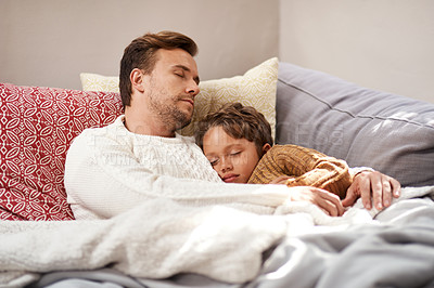 Buy stock photo Cropped shot of a man and his son taking a nap on the couch at home