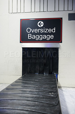 Buy stock photo Shot of a conveyer belt in the baggage claim area of an airport