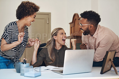 Buy stock photo Shot of a group of businesspeople cheering while working together in an office