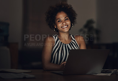 Buy stock photo Portrait of a young businesswoman using a laptop during a late night at work