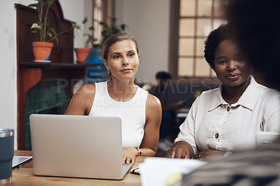 Buy stock photo Shot of a group of young businesswomen having a meeting in a modern office