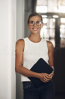 Buy stock photo Portrait of a young businesswoman holding a digital tablet in a modern office